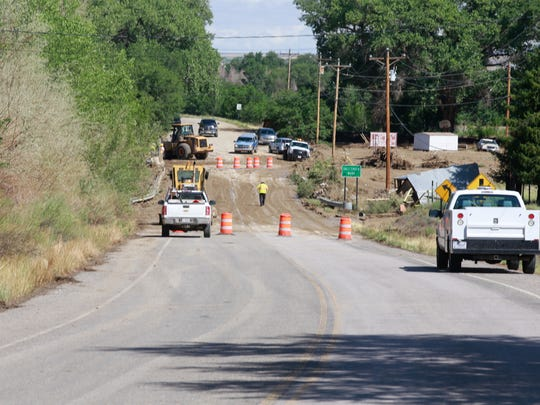 Workers clear debris on Aug. 6 after the Salt Creek