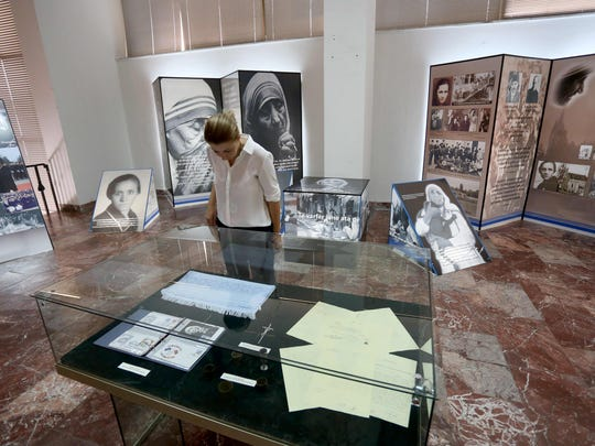 A visitor in Tirana, Albania, looks at a special exhibit