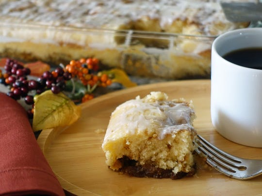 A piece of Cinnamon Roll Cake with a cup of coffee is a great way to start a fall day.