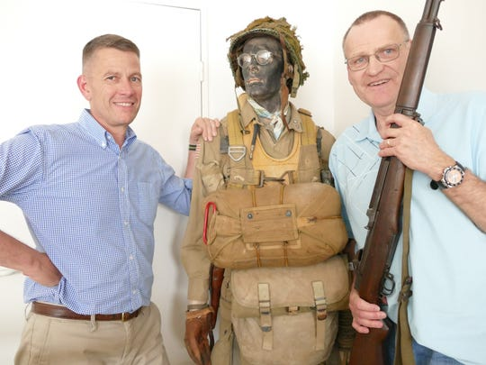 Jim Farrell (right) holds his late Uncle Matty's D-Day