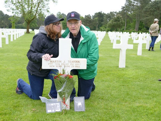 """Monica and Jim Farrell at the Normandy grave of Jim's uncle, Martin """"Matty"""" Teahan."""