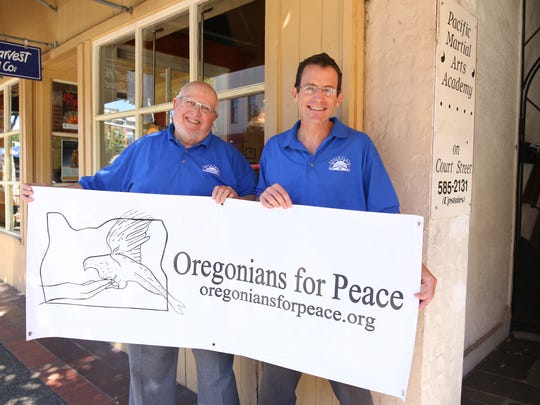 ItÕs a banner month for Mark Babson, right, and Curt