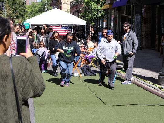 The pickle toss is among the games you can play at Lower East Side Pickle Day.