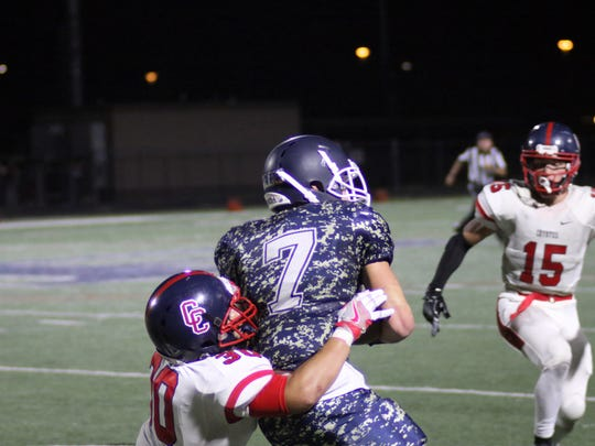 Pinnacle WR/QB Parker Redd is tackled by Centennial