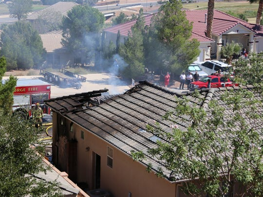 St. George Fire Department firefighters respond to a house fire located at 689 Lava Pointe Dr. on Sept. 19.