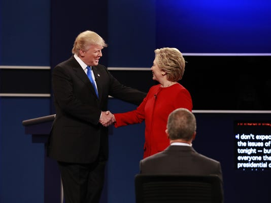 Hillary Clinton and Donald Trump shake hands at the start of their presidential debate at Hofstra University in Hempstead, N.Y.