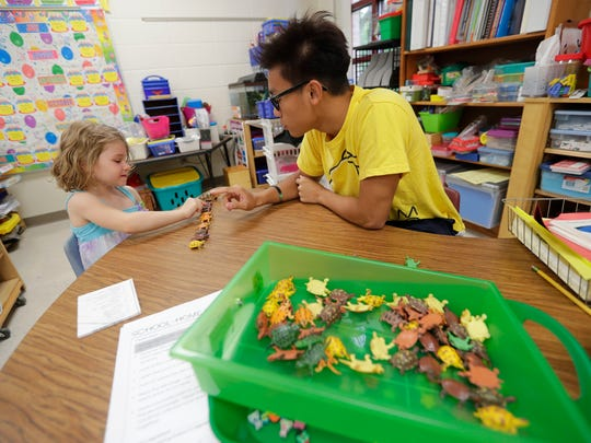 Wilder elementary School and their neighbor, NEW Lutheran High School, have formed a reading program that brings the older students into elementary classrooms to work on reading skills. Kindergarten student Gwen Weber works with NEW Lutheran student Samuel Ma September 28, 2016