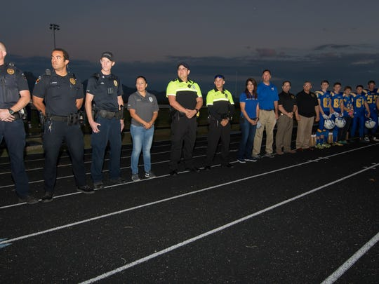 Mesilla Valley Christian School football team honors law enforcement officers and first responders before the start of their game on Friday night, Sept. 30, 2016