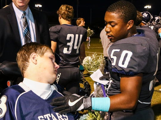 Siegel players talk to Baylor Bramble during night