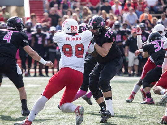 Austin Peay defensive end Lloyd Tubman works against