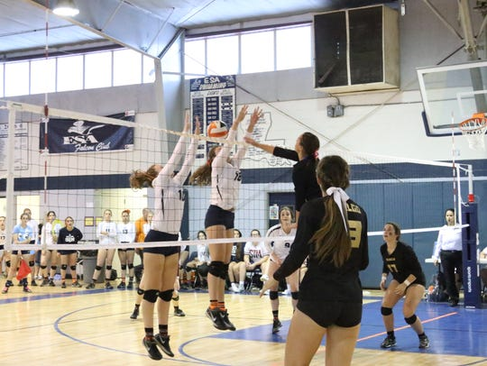 The Teurlings Catholic Lady Rebels on the winning point