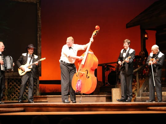 """John Marshall plays the upright bass in """"Ring of Fire"""" at the Riverside Theatre in Vero Beach."""