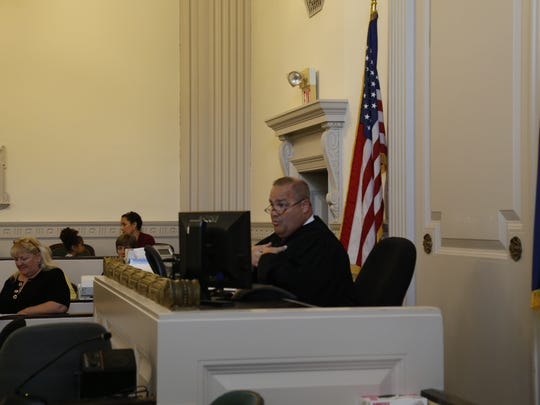 Hon. Eugene Faughnan speaks to the courtroom during a naturalization ceremony on Wednesday, Nov. 2 at Tompkins County Courthouse.