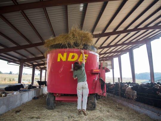 Chris Burger, owner of Century Harvest Farm, throws