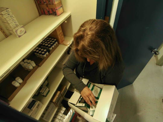 CEO of Planned Parenthood Ruth Lyle-Barnaby stocks the medical closet with medications at Planned Parenthood in Wilmington.