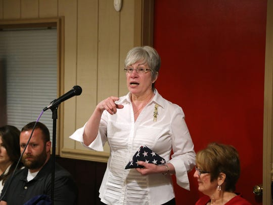 Gold Star Mom Debby Whitsett speaks during a Veterans Appreciation Banquest hosted by  WoodmenLife Greenville Chapter 3. The banquet honored local Veterans with dinner and a certificate recognizing their service.