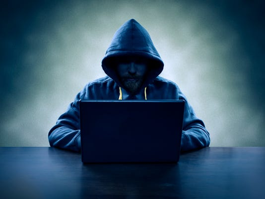 Computer hacker stealing information with laptop