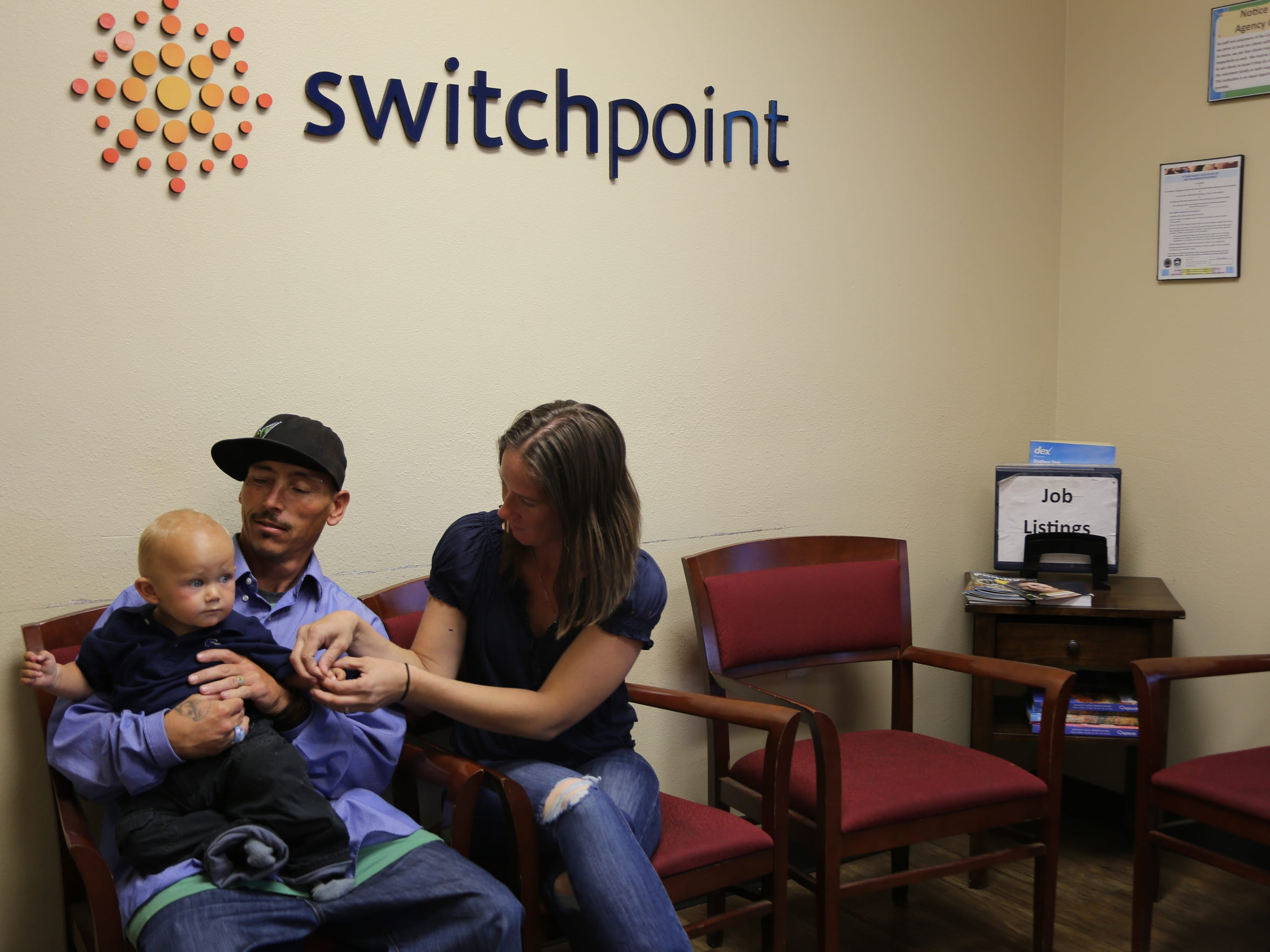 A family at SwitchPoint plays with their 1-year-old