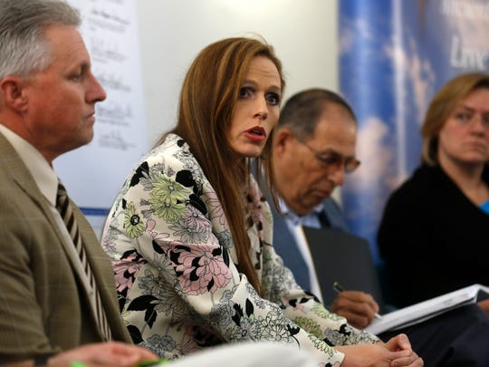 "San Juan College President Toni Pendergrass, center, has started a ""reduction in force"" process at the college that likely will lead to layoffs."
