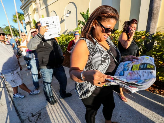 Elaine Nieves of Port Charlotte checks out the deals