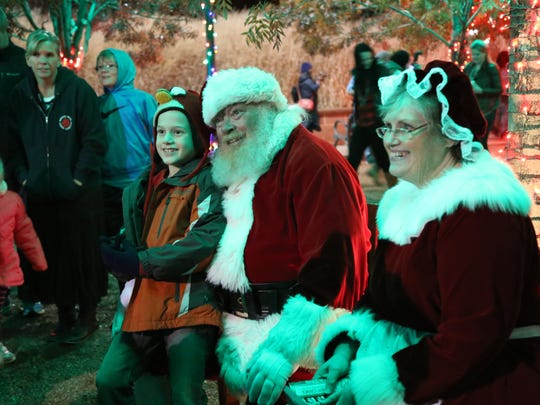 Community members attend the Town Square Christmas Lighting ceremony on St. George Main Street Nov. 28, 2016. Mayor Jon Pike and members of city council led the crowd in Christmas carols after Eric Dodge, Mikalene Ipson, Brodie Perry and more performed musical numbers. Santa Claus and Mrs. Claus paid families a surprise visit.