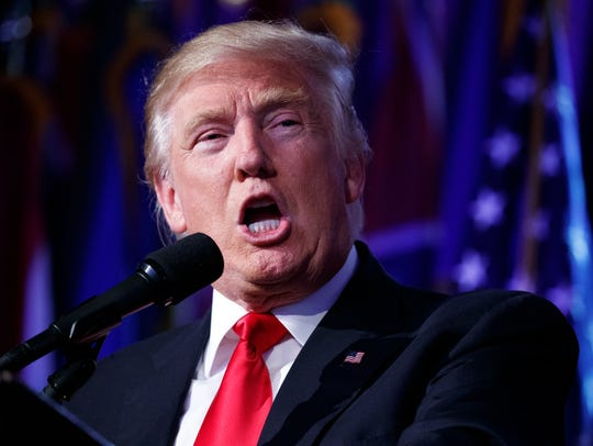 FILE - In this President-elect Donald Trump speaks