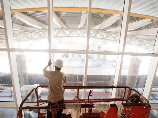 A worker cleans a large window of new enrichment center at Episcopal School of Acadiana's Lafayette campus Dec.1, 2016. The center will open in January. It will have resources including robotics, engineering, history and more.