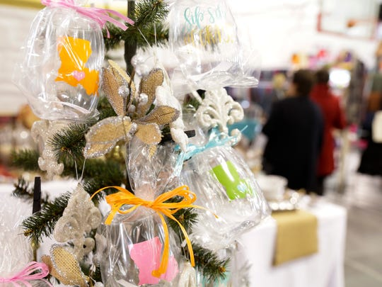 Louisiana-themed wine glasses are displayed at Simply Stella during the Christmas at Coteau Holiday Market at the Academy of the Sacred Heart in Grand Coteau Dec.2, 2016.