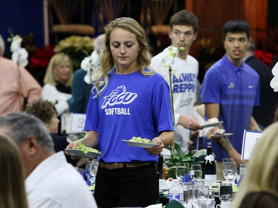 FGCU softball player Bri Innamorato serves during FGCU's annual Night at the Nest Gala which raises money for the athletic department on Friday, Dec . 2, 2016. Attendees were able to participate in the silent auction, live auction while being served dinner by FGCU student-athletes.