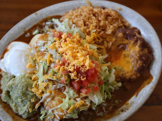 Paula's Special Burrito, also known as a chimichanga, can be ordered with chicken, ground beef, shredded beef, or chili verde. It's typically served enchilada style with sour cream, guacamole, tomatoes, cheese and lettuce.