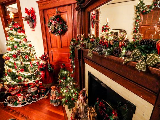 The Fort Myers Woman's Community Club decorates the historic Burroughs and Langford Kingston homes every year for the popular Holiday House display.