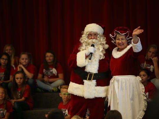 Santa Claus and Mrs. Claus speak to Hurricane Elementary