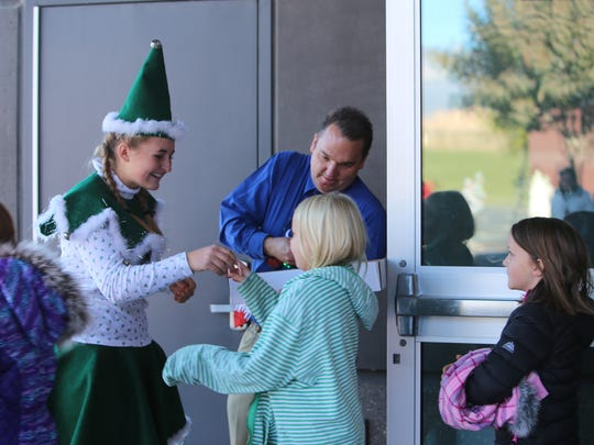 Emily Fryer, one of Santa's elves, and Hurricane Elementary