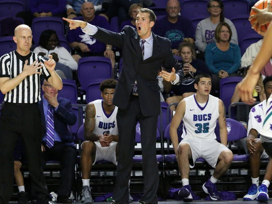 FSW coach Marty Richter directs the defense during FSW's home game against ASA College on Wednesday, Dec. 7, 2016 at Suncoast Credit Union Arena.