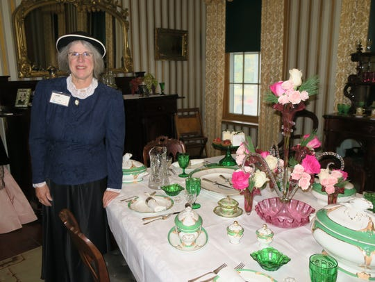 Cathy Grifor shows an elaborately decorated dining