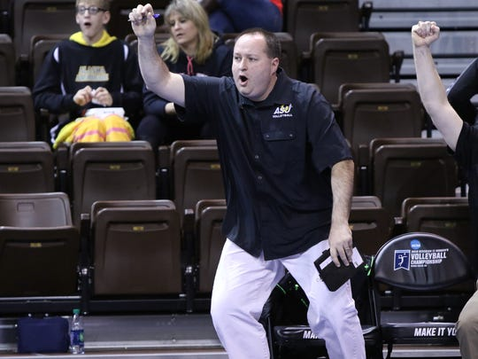 Head coach Chuck Waddington of Angelo State reacts to a point during Thursday's NCAA Division II national quarterfinal match in Sioux Falls, South Dakota.