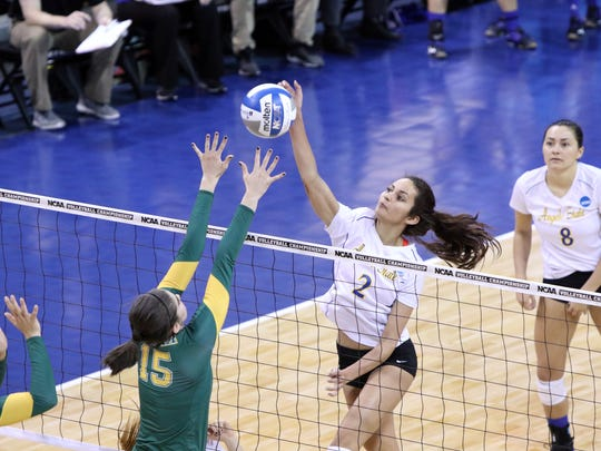 Morgan Seaton of Angelo State spikes the ball past the defense of Erin Braun of Alaska Anchorage during Thursday's NCAA Division II national quarterfinal match in Sioux Falls, South Dakota.