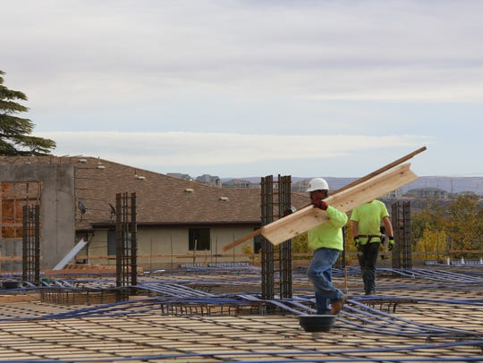 Crews with Bonneville Builders work on a new housing