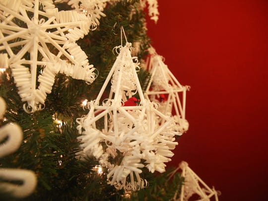 Ornaments made by 87-year-old Ann Keraminas hang from a tree in her assisted living center on Dec. 6, 2016. Keraminas, originally from Lithuania is a Holocaust survivor and continues to make traditional straw ornaments she learned to make as a child.