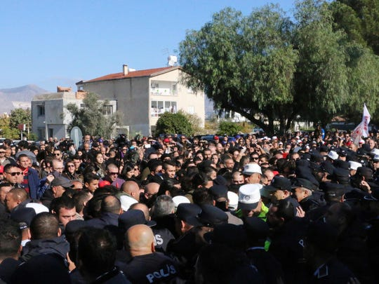 Turkish Cypriots take part in a protest on December