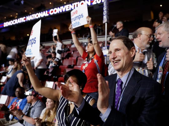 FILE- In this July 25, 2016, file photo, Sen. Ron Wyden, D-Ore., applauds during the first day of the Democratic National Convention in Philadelphia. Penn. A frequent critic of the pharmaceutical industry, despite receiving more than $40,000 from opioid drugmakers to his campaigns and his leadership PAC in the past decade, Wyden proposed eliminating the exemption and using the $75 million to fund addiction treatment for low-income pregnant women, who must forfeit their Medicaid prenatal coverage before seeking treatment. (AP Photo/Matt Rourke, File)