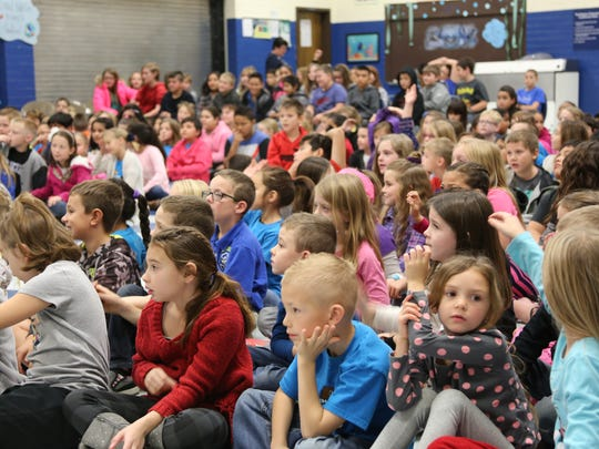 Washington County School District students listen to state politicians and Utah Educational Savings Account officials during an assembly in this file photo from Dec. 2016.