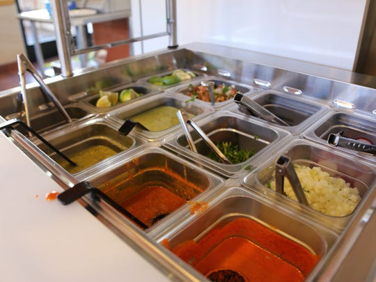 The sauce bar at La Cocina offers fresh toppings and salsa for its authentic street tacos.