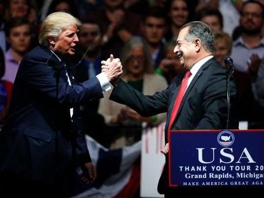 President-elect Donald Trump thanks Dow Chemical Company Chairman and Chief Executive Officer Andrew Liveris during a rally, in Grand Rapids, Friday, Dec. 9, 2016.