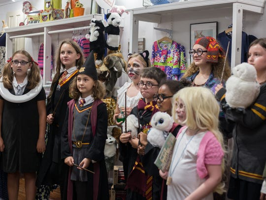 Young participants dressed as characters from the magical