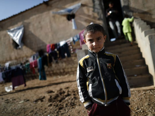 A displaced Iraqi boy, who fled the violence in the