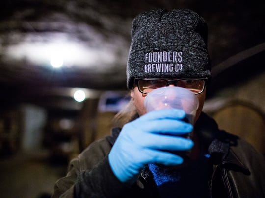 "Jeremy Kosmicki, Founders Brewing Company's Brewmaster, tries Founders' ""Backwoods Bastard"" which had been aging in a barrel since 2011 in a mine 85 feet underground at Michigan Natural Storage in Grand Rapids, Mich."