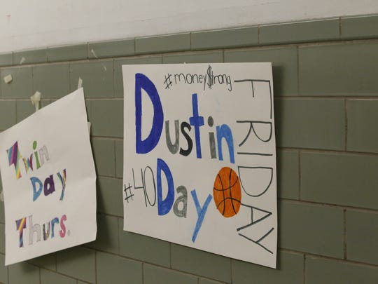 A sign hanging in the hallway of Moravia Central Schools made for Dustin Mondics, a member of the Moravia basketball team who suffered serious injuries in a car accident on Dec. 27 while heading to basketball practice.