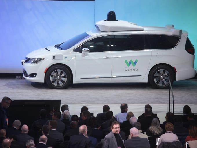 An autonomous hybrid Chrysler Pacifica minivan is seen