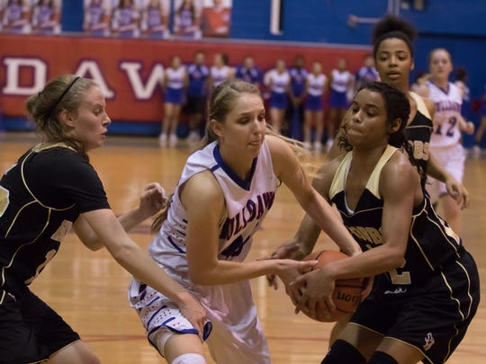 Las Cruces High's Sarah Abney fights for possession against Hobbs on Tuesday at LCHS.